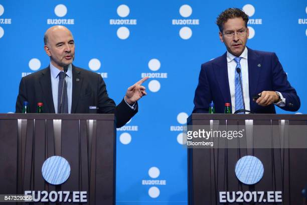 Pierre Moscovici economic commissioner for the European Union left gestures as he speaks during a news conference with Jeroen Dijsselbloem Dutch...