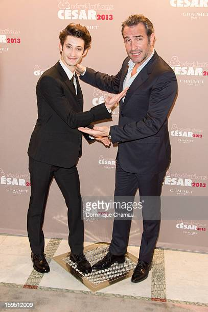 Pierre Niney and Jean Dujardin attend the 'Cesar's Revelations 2013' Dinner Arrivals at Le Meurice on January 14 2013 in Paris France