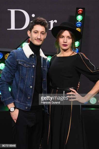 Pierre Niney and Natasha Andrews attend Dior Homme Menswear Fall/Winter 20182019 show as part of Paris Fashion Week at Grand Palais on January 20...
