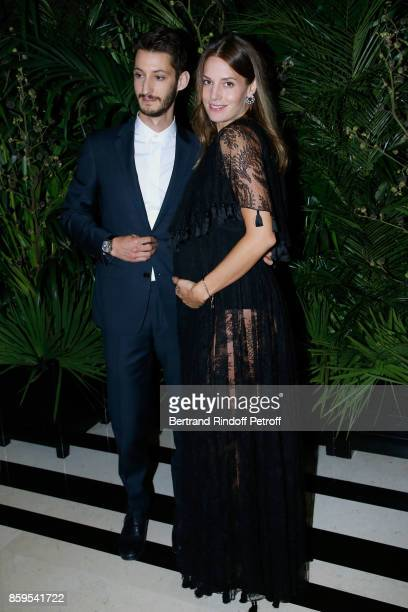 Pierre Niney and Natasha Andrews attend the 'Diner des Amis de Care' at Hotel Peninsula Paris on October 9 2017 in Paris France