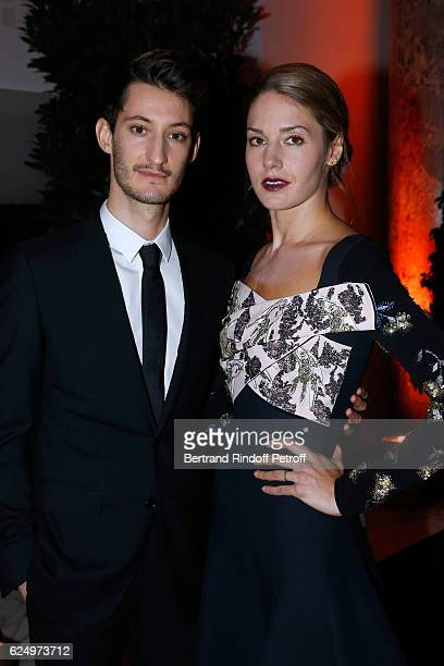 Pierre Niney and Natasha Andrews attend the 'Diner des amis de Care' for the 70th anniversary of the Association Held at Espace Cambon on November 21...