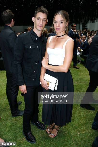 Pierre Niney and Natasha Andrews attend the Dior Homme Menswear Spring/Summer 2018 show as part of Paris Fashion Week on June 24 2017 in Paris France