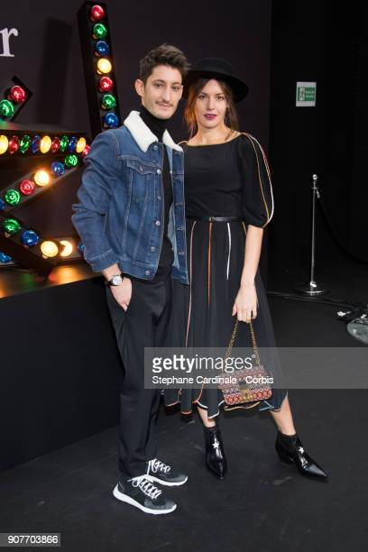 Pierre Niney and Natasha Andrews attend the Dior Homme Menswear Fall/Winter 20182019 show as part of Paris Fashion Week on January 20 2018 in Paris...