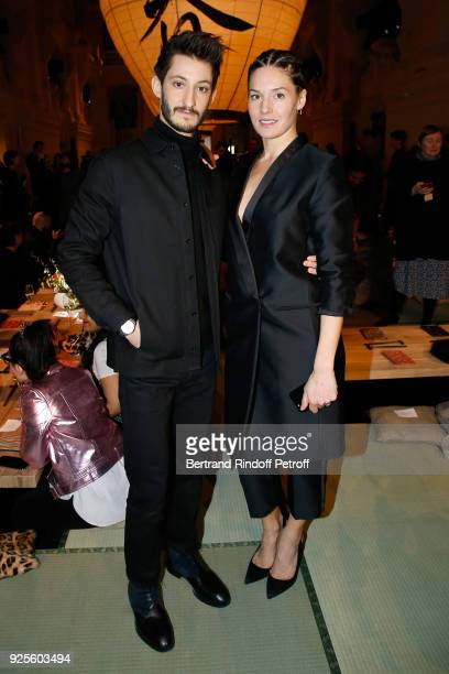 Pierre Niney and Natasha Andrews attend the HM show as part of the Paris Fashion Week Womenswear Fall/Winter 2018/2019 on February 28 2018 in Paris...