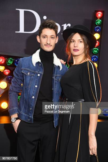 Pierre Niney and Natasha Andrews pose at Dior Homme Menswear Fall/Winter 20182019 show as part of Paris Fashion Week at Grand Palais on January 20...