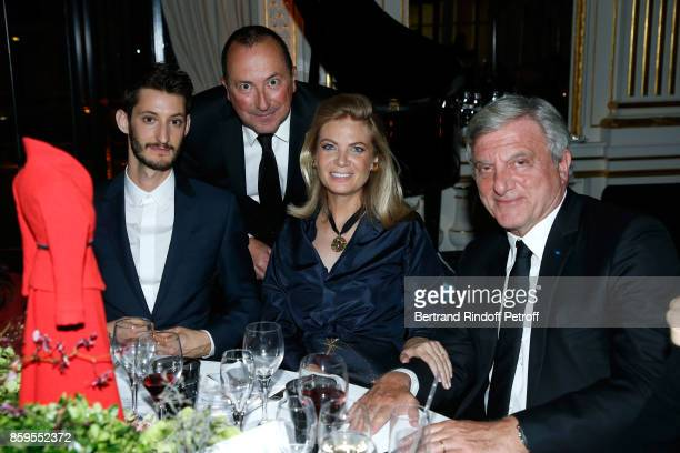 Pierre Niney General Director of Care France Philippe Leveque President of Care France Arielle de Rothschild and CEO Dior Sidney Toledano attend the...