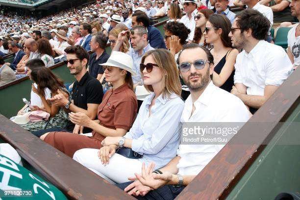 Pierre Niney Natasha Andrews and Cyril Lignac attend in the Lacoste loge the Men Final of the 2018 French Open Day Fithteen at Roland Garros on June...