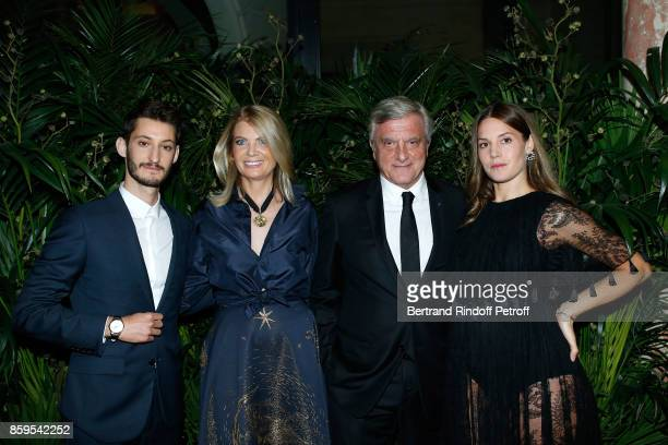 Pierre Niney President of Care France Arielle de Rothschild CEO Dior Sidney Toledano and Natasha Andrews attend the 'Diner des Amis de Care' at Hotel...