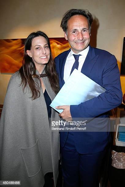 Pierre Olivier and Alexandra Sur attend the 'Eugenia Grandchamp Des Raux' Danse Exhibition at Galerie Pierre Passebon on June 10 2014 in Paris France