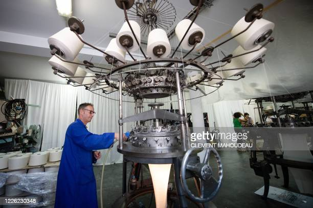 Pierre Parisi machine operator for the Sugar clothes brand works on a weaving loom in the Sugar clothes brand factory in Marseille south of France on...