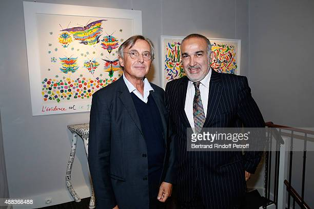 Pierre Passebon and Galerist of Gallery Tindouf in Marrakech and Tanger Boubker Temli attend the 'Paintings Poems from Tahar Ben Jelloun Furniture...