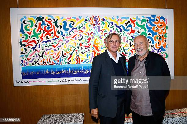 Pierre Passebon and Writer Tahar Ben Jelloun attend the 'Paintings Poems from Tahar Ben Jelloun Furniture Scriptures from CSaccomanno ODayot' Press...