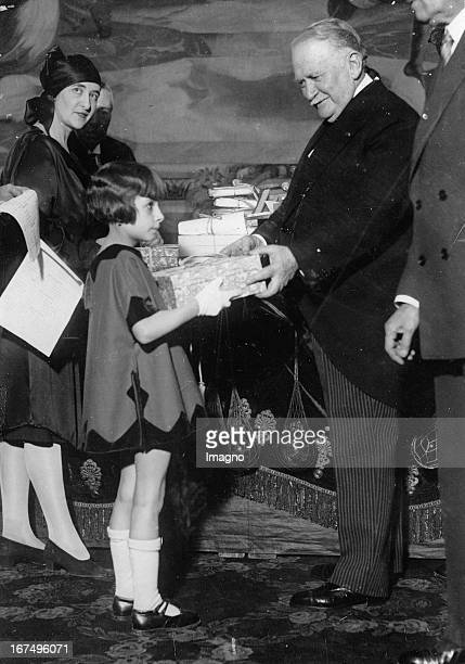 Pierre Paul Henri Gaston Doumergue was a French politician and one of the president of the Third Republic The picture shows him giving Christmas...