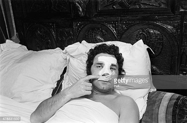Pierre PERRET's portrait, confined to bed at his home, hurt, showing its dressing on the face.