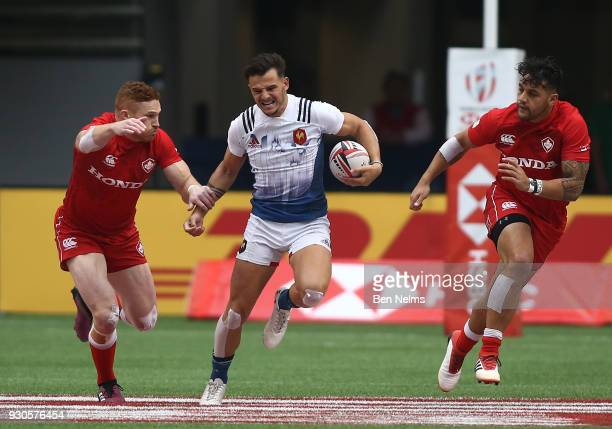Pierre Popelin of France runs the balls against Connor Braid of Canada during the Canada Sevens the Sixth round of the HSBC Sevens World Series at...