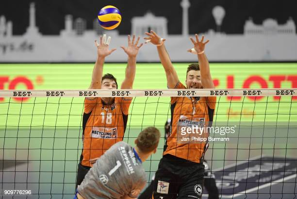 Pierre Pujol of the Berlin Recycling Volleys Georg Klein of VfB Friedrichshafen and Aleksandar Okolic of the Berlin Recycling Volleys during the game...