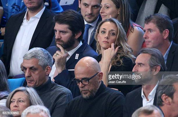 Pierre Rabadan and Laurie Delhostal attend the 25th IHF Men's World Championship 2017 Semi Final handball match between France and Slovenia at...