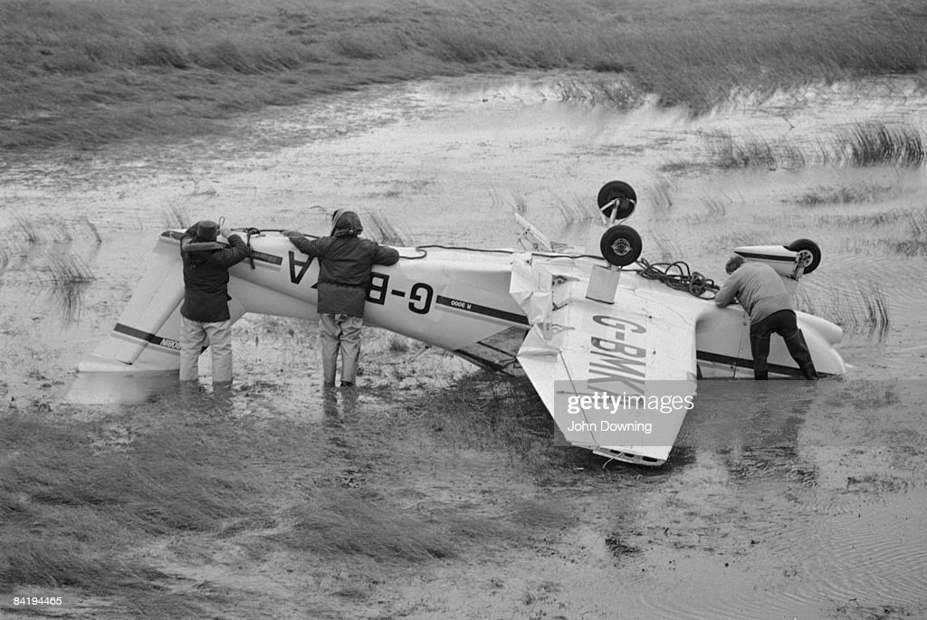 Pierre Robin light aircraft G-BMKA is found upside-down in a field after the Great Storm in southern England, 17th October 1987.