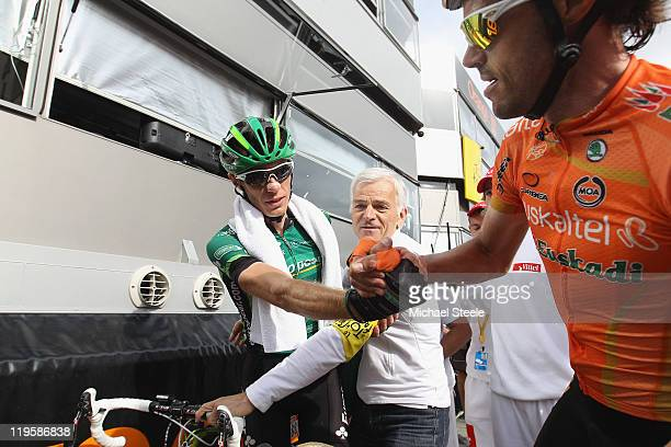 Pierre Rolland of France and Team Europcar shakes hands with Samuel Sanchez of Spain and Team EuskaltelEuskadi after winning Stage 19 of the 2011...