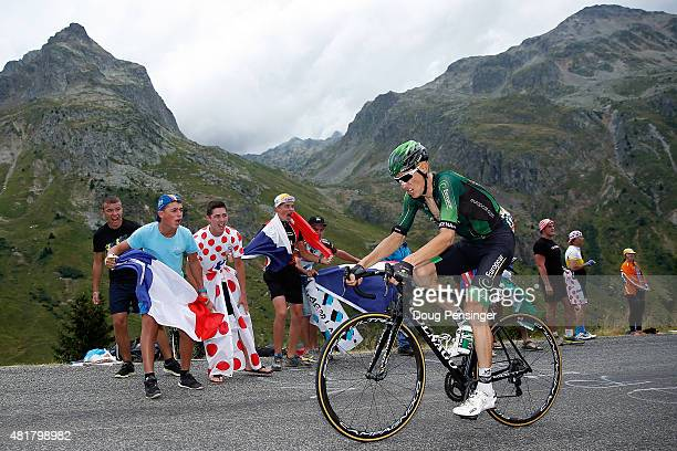 Pierre Rolland of France riding for Team Europcar is encouraged by supporters as he rides alone at the front of the race on the Col de la Croix de...