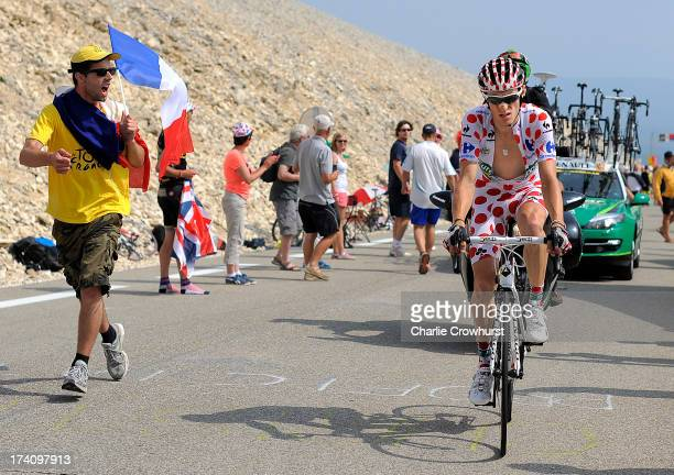 Pierre Rolland of Team Europcar is cheered home by a spectator during stage fifteen of the 2013 Tour de France a 2425KM road stage from Givors to...