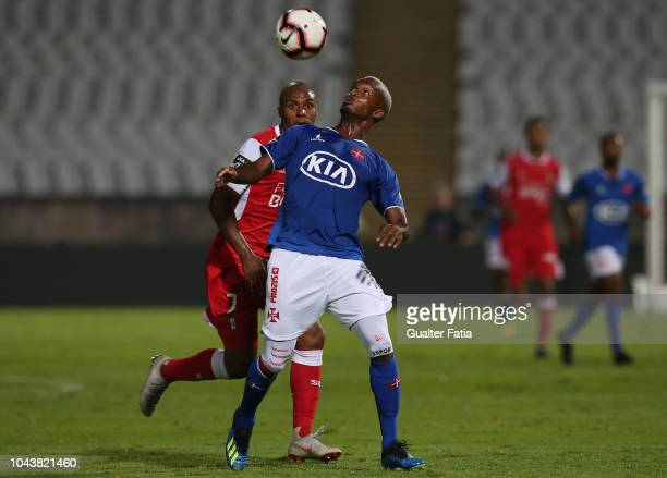 Pierre Sagna of Belenenses SAD with Wilson Eduardo of SC Braga in action during the Liga NOS match between Belenenses SAD and SC Braga at Estadio...