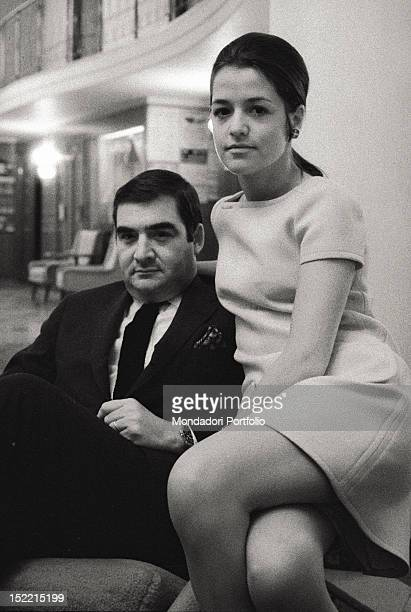 Pierre Salinger the former White House press secretary to US president John F Kennedy with his wife Nicole seated in the livingroom of their house...