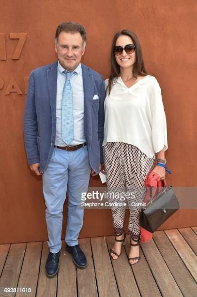 Pierre Sled and a guest attend the French Tennis Open 2017 Day Twelve at Roland Garros on June 8 2017 in Paris France