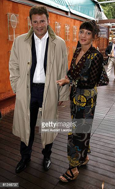 Pierre Sled and LCI TV presenter Erika Moulet arrive at the 'Village' the VIP area of the French Open at the Roland Garros arena on May 27 2008 in...