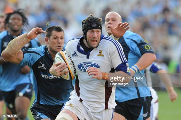 Pierre Spies can not stop Tom Donnelly from scoring during the Super 14 match between Blue Bulls and Highlanders held at Loftus Versfeld Stadium on...