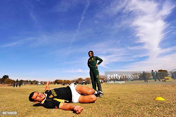 Pierre Spies carries out some stretching exercises with the assistance of physio Rene Naylor during a Springboks training session at Fourways High...