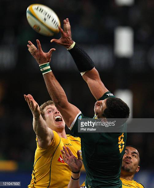 Pierre Spies of the Springboks and David Pocock of the Wallabies compete for the ball during the TriNations match between the South African...