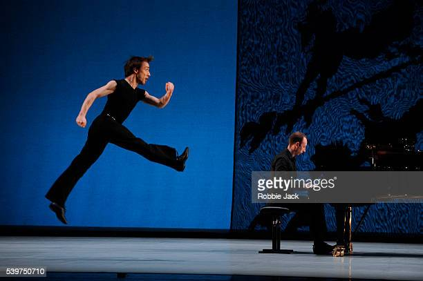 """Pierre Tappon with Jason Ridgway on piano performing in Richard Alston's """"Movements from Petrushka"""" at Sadlers Wells in London."""