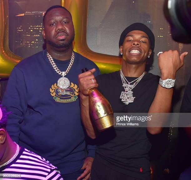 Pierre Thomas and Lil Baby attend Lil Baby Harder Than Ever Mixtape Release Event at Living Room Lounge on May 17 2018 in Atlanta Georgia