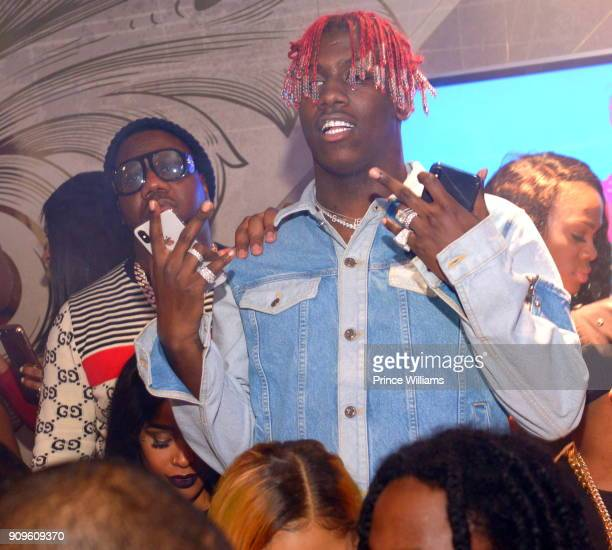 Pierre Thomas and Lil Yachty attend the Grand Opening of Empire Lounge on January 22 2018 in Atlanta Georgia