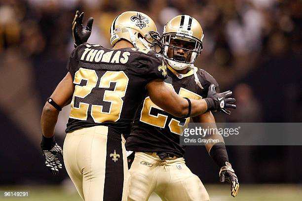 Pierre Thomas and Reggie Bush of the New Orleans Saints celebrate after Thomas scored a touchdown against the Minnesota Vikings during the NFC...
