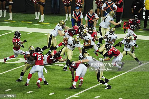 Pierre Thomas of the New Orleans Saints carries the ball against the Atlanta Falcons at the Georgia Dome on December 27 2010 in Atlanta Georgia