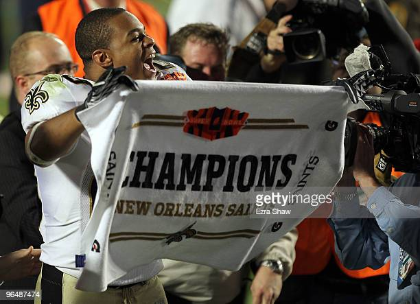 Pierre Thomas of the New Orleans Saints celebrates after defeating the Indianapolis Colts during Super Bowl XLIV on February 7 2010 at Sun Life...