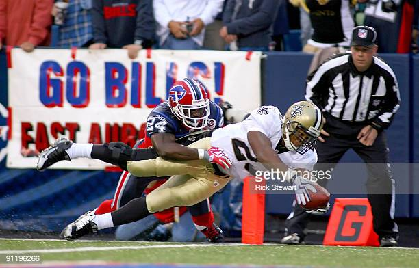 Pierre Thomas of the New Orleans Saints dives for the pylon to score a touchdown as Terrence McGee defends for the Buffalo Bills at Ralph Wilson...