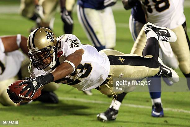 Pierre Thomas of the New Orleans Saints leaps into the end zone to score a touchdown against of the Indianapolis Colts in the third quarter during...
