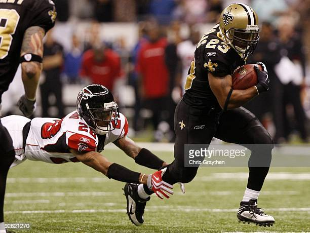 Pierre Thomas of the New Orleans Saints out runs Thomas DeCoud of the Atlanta Falcons during the game at the Louisiana Superdome on November 2 2009...