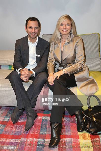 Pierre Tizzani and Michaela Merten attend the opening of the Roche Bobois shop on January 31 2013 in Munich Germany