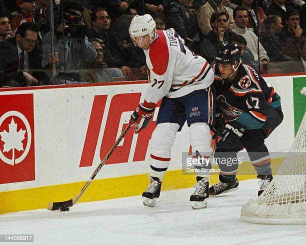 Pierre Turgeon of the Montreal Canadiens skates behind the net with the puck Circa 1996 at the Montreal Forum in Montreal, Quebec, Canada.