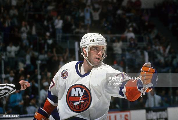 Pierre Turgeon of the New York Islanders celebrates a goal during an NHL game circa 1992 at the Nassau Coliseum in Uniondale New York