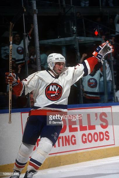 Pierre Turgeon of the New York Islanders celebrates a goal during an NHL game circa 1992 at the Nassau Coliseum in Uniondale, New York.