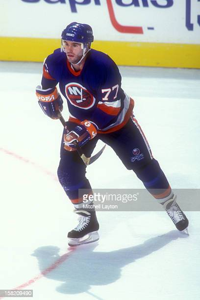 Pierre Turgeon of the New York Islanders during a hockey game against the Washington Capitals on April 5 1994 at USAir Arena in Landover Maryland The...