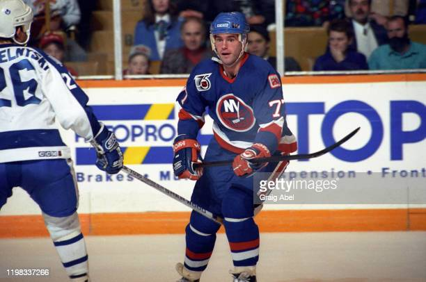 Pierre Turgeon of the New York Islanders skates against the Toronto Maple Leafs during NHL game action on December 11, 1991 at Maple Leaf Gardens in...