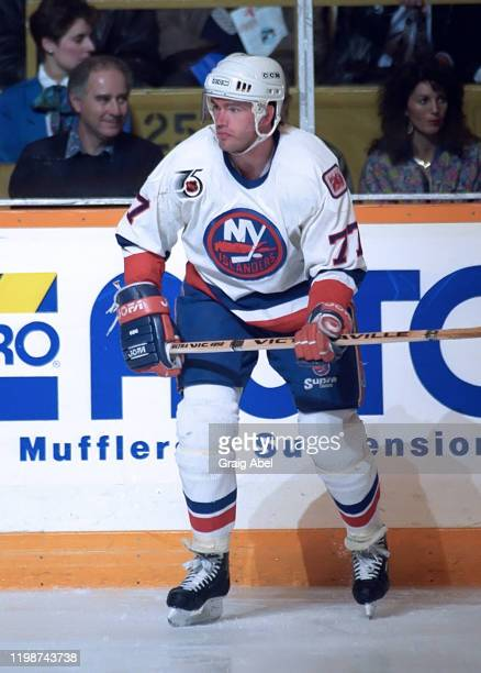Pierre Turgeon of the New York Islanders skates against the Toronto Maple Leafs during NHL game action on April 12, 1992 at Maple Leaf Gardens in...