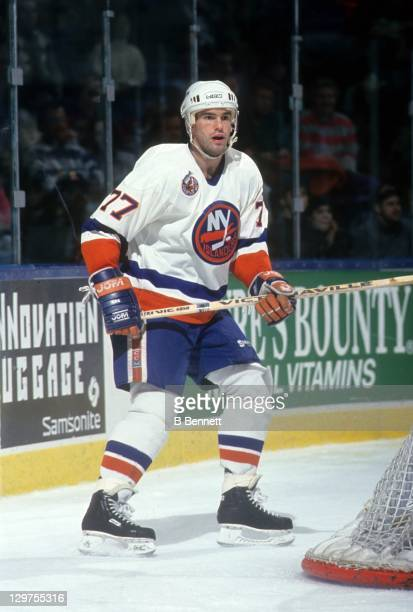 Pierre Turgeon of the New York Islanders skates behind the net during an NHL game in January 1993 at the Nassau Coliseum in Uniondale New York