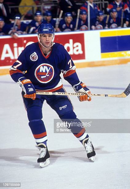 Pierre Turgeon of the New York Islanders skates on the ice during an NHL game circa 1993.